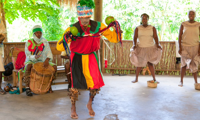 In traditional costumes, Garifuna dancers show their cultural roots at Yubu Garifuna Experience. Roatan, Honduras